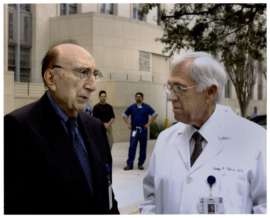 Dr. Bobby R. Alford, right, and Dr. Michael E. DeBakey standing outside Baylor College of Medicine's Cullen building. Alford died Tuesday, after 55 years at the Houston medical school. Photo: National Library Of Medicine