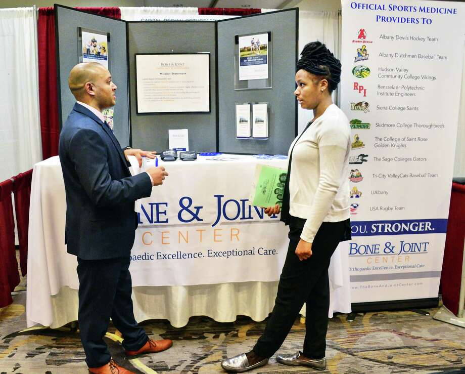 Sanjay Nash, left, from the Bone & Joint Center speaks with job seeker Kahdesha Joseph of Albany during the TU Health Career Job Fair at the Albany Marriott hotel Tuesday Feb. 20, 2018 in Colonie, NY.  (John Carl D'Annibale/Times Union) Photo: John Carl D'Annibale / 20042975A