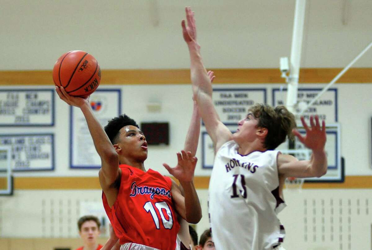 Green Farms Academy's Tyrone Holloway looks for two points as Hopkins' Cameron Delcristo defends during basketball action in Westport, Conn., on Tuesday Feb. 20, 2018.