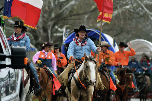 Sam Houston trail riders Glenda Fraysur, left, of Hockley, and Taryn Sims, right, of Cypress, lead their fellow riders into the Tomball Depot for the annual Tomball Trail Ride celebration held at the depot on Feb. 20, 2018. (Photo by Jerry Baker/Freelance)