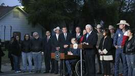 By the side of the Sutherland Springs, Texas First Baptist Church, U. S. Vice President Mike Pence and Texas Gov. Greg Abbott address the media, Wednesday, Nov. 8, 2017. With them are their spouses, Karen Pence and Cecilia Abbott.