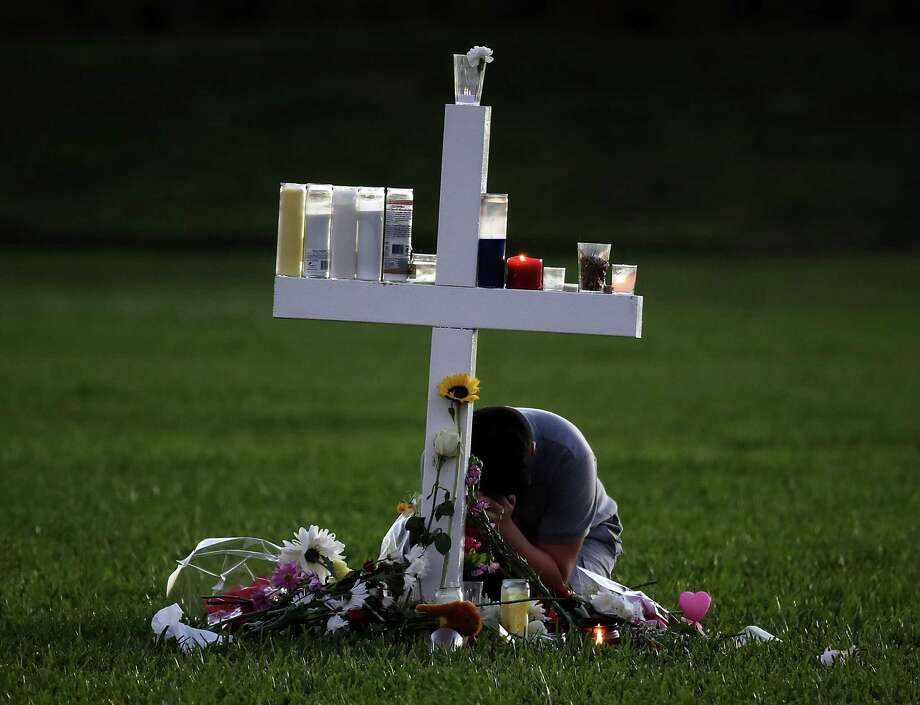 A memorial cross in Parkland, Fla., honors victims of the shooting at Marjory Stoneman Douglas High School. Photo: Mark Wilson, Staff / 2018 Getty Images