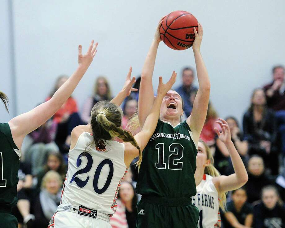 Sacred Heart's Claire Liddy, right, grabs an offensive rebound over Greens Farms Academy's Kelly Van Hoesen during the FAA quarterfinal game on Tuesday in Greenwich. Photo: Bob Luckey Jr. / Hearst Connecticut Media / Greenwich Time