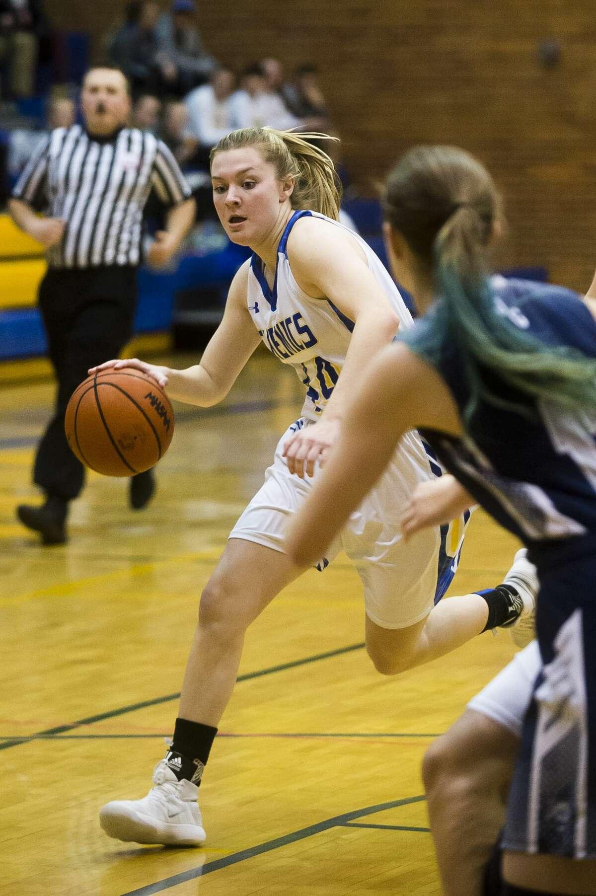 Midland senior Maddie Barrie dribbles toward the basket during the Chemics' game against John Glenn on Tuesday, Feb. 20, 2018 at Midland High School. (Katy Kildee/kkildee@mdn.net)