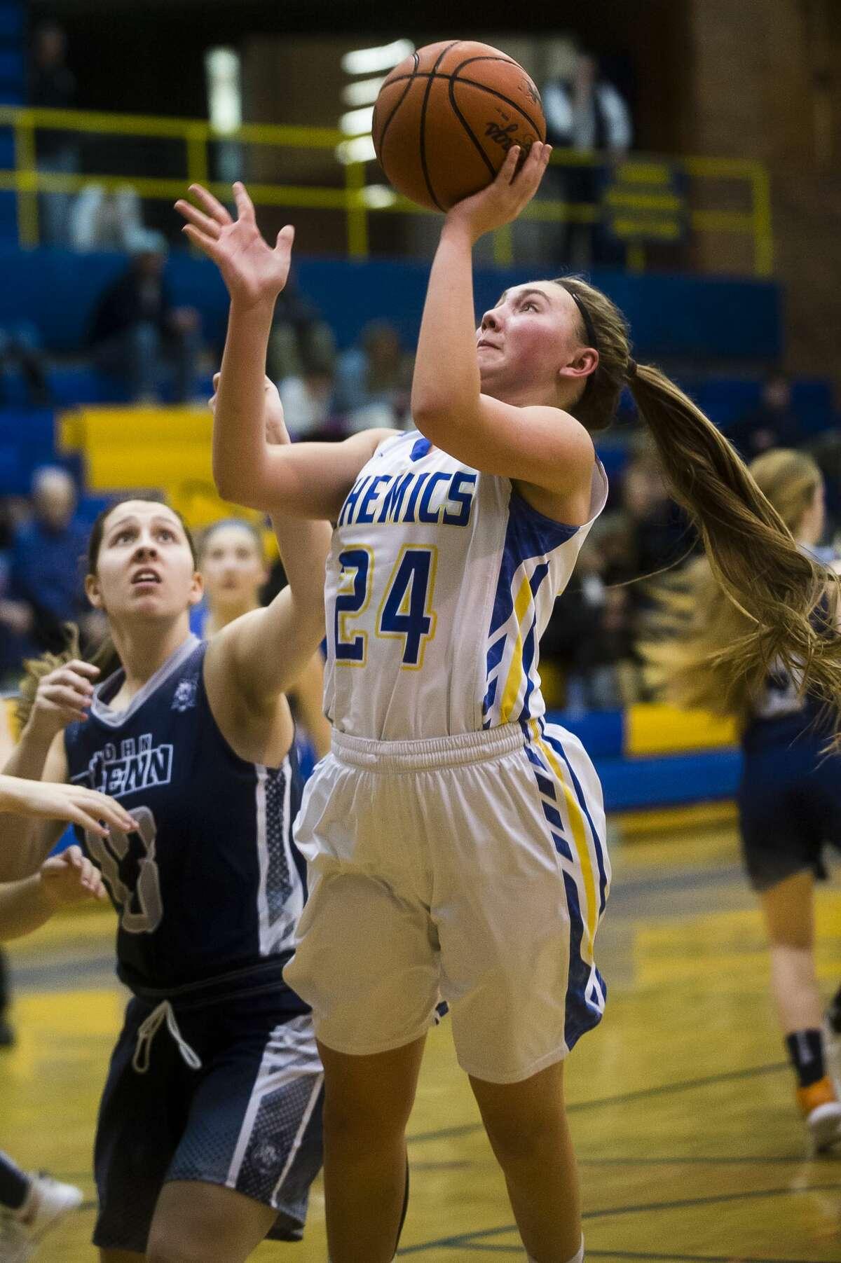 Midland senior Hannah Smith takes a shot during the Chemics' game against John Glenn on Tuesday, Feb. 20, 2018 at Midland High School. (Katy Kildee/kkildee@mdn.net)