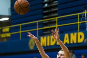 Midland senior Hannah Smith takes a shot during the Chemics' game against John Glenn on Tuesday, Feb. 20, 2018 at Midland High School. (Katy Kildee/kkildee@mdn.net)