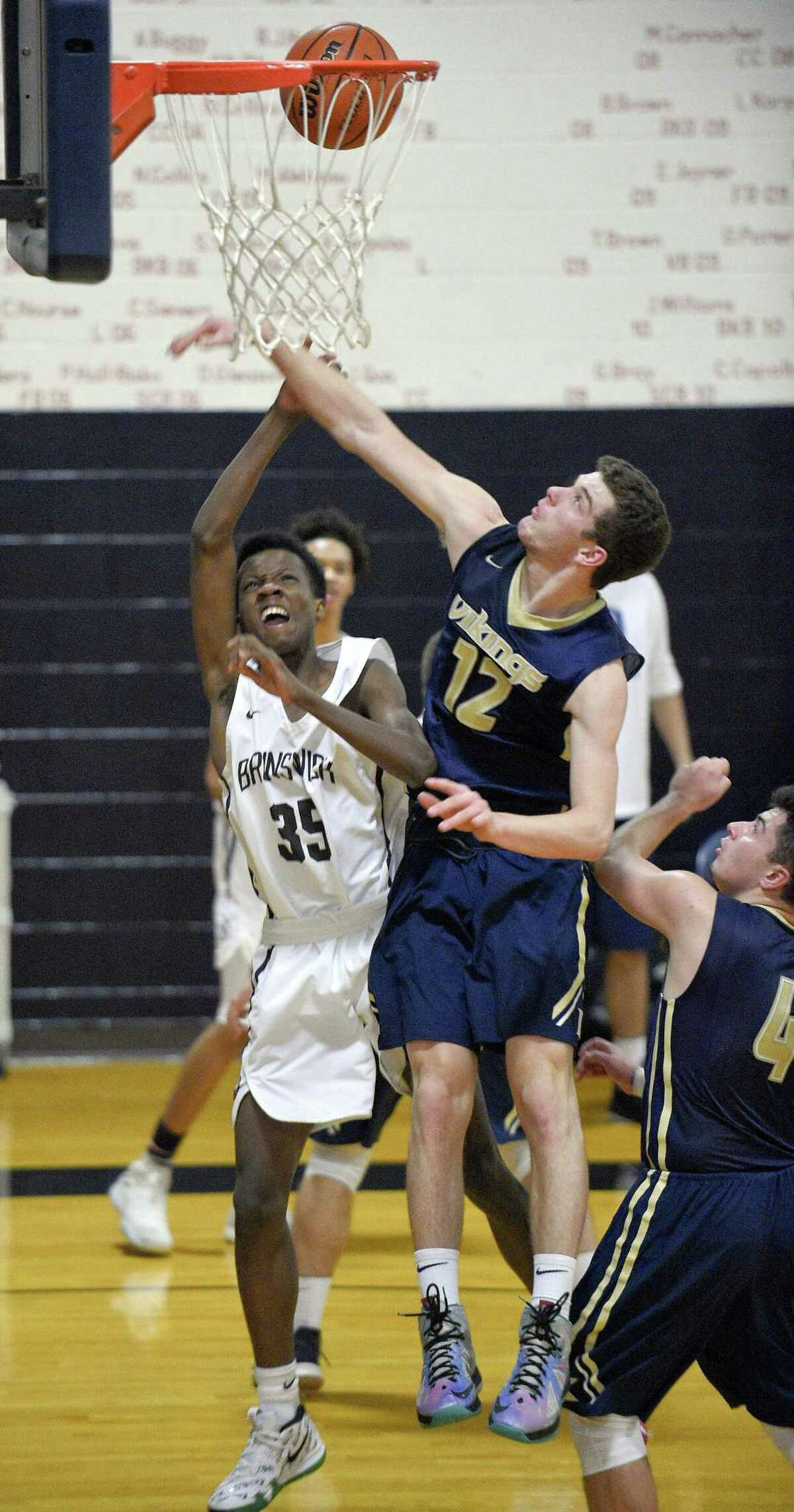 Brunswick Tristan Joseph (35) puts up a shot under pressure from King Renn Lints (12) in a FAA Boys Basketball Quarter Final game at King School on Tuesday, Feb. 20, 2018 in Stamford, Connecticut.