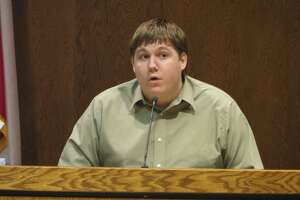 Justin Carter testifies at pre-trial hearing in Comal County on Aug. 27, 2014. Carter is charged with making a terroristic threat over a Feb. 13, 2013 Facebook entry in which he wrote about shooting up a kindergarten. He claims he was joking.