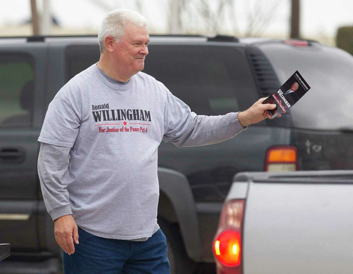 Ronald Willingham, candidate for Montgomery County Precinct 4 Justice of the Peace, looks to hand out push cards on the first day of Early Voting at the East Montgomery County Courthouse, Tuesday, Feb. 20, 2018, in New Caney.
