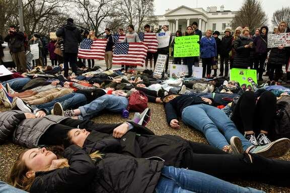 "Students stage a ""lie-in"" Monday outside the White House in response to the school shooting Wednesday in Florida. The teens said they want stronger gun control and vowed to be heard on the issue. MUST CREDIT: Washington Post photo by Bill O'Leary"
