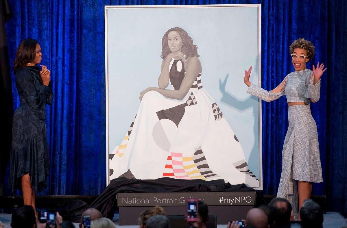 TOPSHOT - Former US First Lady Michelle Obama (L) and artist Amy Sherald (R) unveil Mrs. Obama's portrait at the Smithsonian's National Portrait Gallery in Washington, DC, February 12, 2018. / AFP PHOTO / SAUL LOEB / RESTRICTED TO EDITORIAL USE - MANDATORY MENTION OF THE ARTIST UPON PUBLICATION - TO ILLUSTRATE THE EVENT AS SPECIFIED IN THE CAPTIONSAUL LOEB/AFP/Getty Images