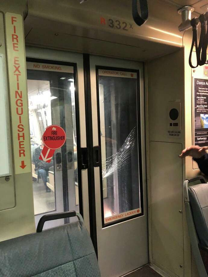 Cracked glass on a BART door after a would-be thief reportedly attempting to steal a passenger's phone resulted in a scuffle. Photo: Courtesy Of CJ Silverio