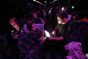 Demitri Hoth, right, asks for feedback from Bailey Feuerman, on an open letter he is writing to legislators, as they and fellow student survivors from Marjory Stoneman Douglas High School, ride aboard their bus between Parkland , Fla., and Tallahassee, Fla., Tuesday, Feb. 20, 2018, to rally outside the state capitol and talk to legislators about gun control reform. Former student Nikolas Cruz opened fire in the school Wednesday, killing 17 students and faculty. (AP Photo/Gerald Herbert)