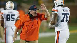 Ex-Auburn assistant Herb Hand has joined UT as co-offensive coordinator, but who'll be calling the plays is still up in the air.