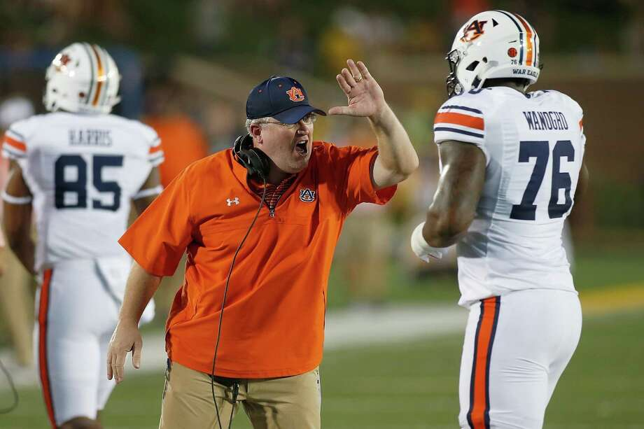 COLUMBIA, MO - SEPTEMBER 23: Auburn Tigers offensive line coach Herb Hand celebrates with lineman Prince Tega Wanogho (76) after a touchdown during the first half of a college football game against the Auburn Tigers, Saturday, September 23, 2017, at Memorial Stadium in Columbia Missouri. (Photo by Scott Kane/Icon Sportswire via Getty Images) Photo: Scott Kane, Contributor / Getty Images / ©Icon Sportswire (A Division of XML Team Solutions) All Rights Reserved contact: info@iconsportswire.com http://iconsportswire.c