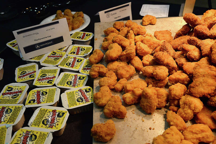 Tyson snacks are offered at the 18th annual Region 5 Food Service Cooperative's food show and tasting at the Civic Center Tuesday. Food service workers, teachers, administrators and students from the region's 50 districts, charter schools, churches and childcare centers got a chance to sample some of the latest menu items geared toward school cafeterias. With a shared goal of taste and nutrition in mind, vendors offered up a variety of food and beverages. Samplers then could vote on which of the items they liked best. The event offers districts the chance to improve upon their menus. Photo taken Tuesday, February 20, 2018 Kim Brent/The Enterprise Photo: Kim Brent / BEN