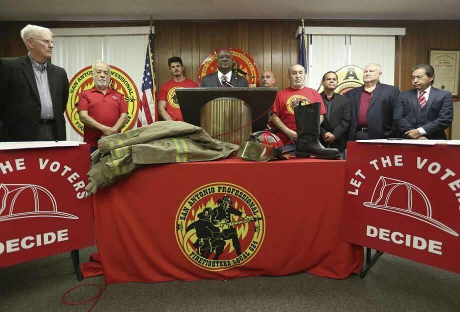 Chris Steele, San Antonio Professional Fire Fighters union president, at lectern,  announces Tuesday, Feb. 20, 2018, during a union hall news conference the union is starting a petition drive calling for three city charter amendments for the November ballot. Photo: William Luther, Staff / San Antonio Express-News / © 2018 San Antonio Express-News