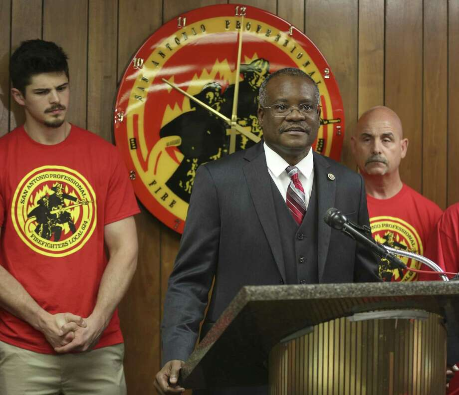 San Antonio Professional Firefighters Association President Chris Steele (at lectern) announced last month that the union was starting a petition drive seeking three proposed amendments to the city charter. Photo: Express-News File Photo / © 2018 San Antonio Express-News