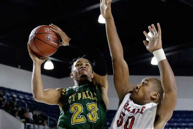Cy Falls' Nigel Hawkins puts up a shot against Bellaire's Marcus Cooper during the second half of their game in the Bi-District playoffs at Delmar Field House in Houston, TX, Feb. 20, 2018. (Michael Wyke / For the  Chronicle)