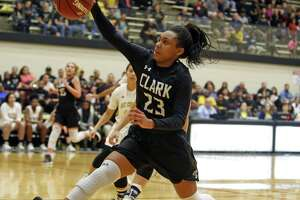 Clarks'Ta'niya Jackson loses control of the ball as she tries to score from the Class 6A third-round girls high school basketball game between Clark and East Central on Tuesday, February 20, 2018