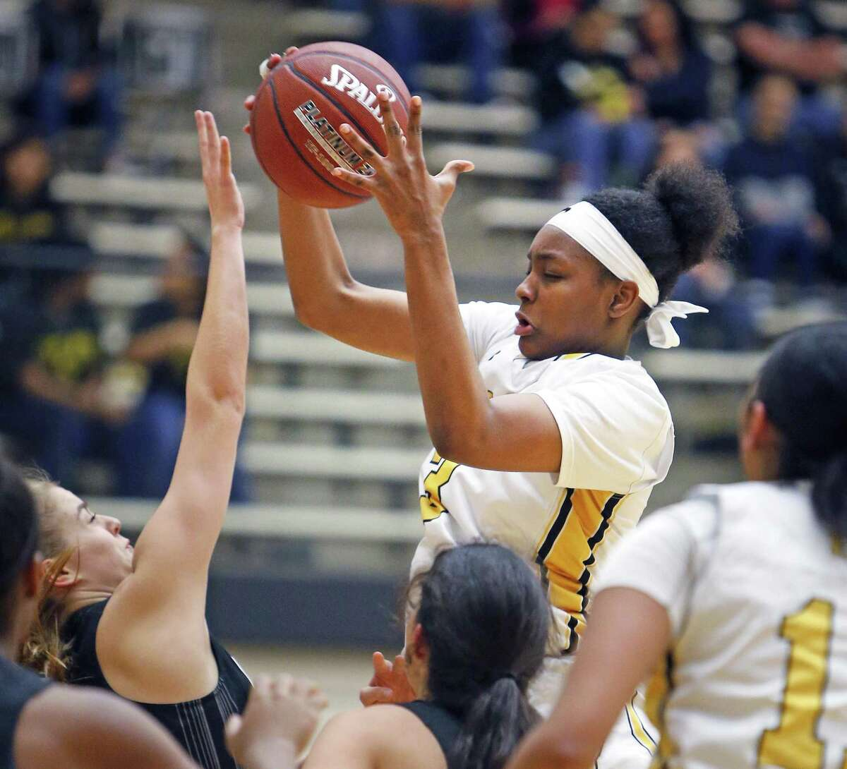 East Centrals?' Nalyssa Smith (C) grabs a lob and put into two against Clark from the Class 6A third-round girls high school basketball game between Clark and East Central on Tuesday, February 20, 2018