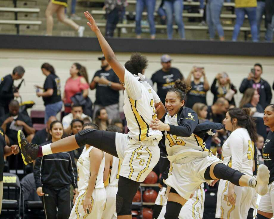 East Centrals' Nalyssa Smith (C) celebrates with East Centrals' Gabriella Ivarra,R at the end of the game from the Class 6A third-round girls high school basketball game between Clark and East Central on Tuesday, February 20, 2018 Photo: Ronald Cortes, For The San Antonio Express News / 2018 Ronald Cortes