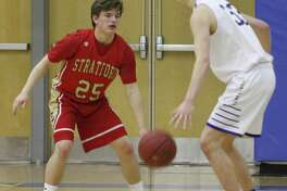 Newtown's Robert DiSibio, right, looks for an opening as Stratford's John Bike defends during the boys basketball game at Newtown High School Feb. 20, 2018.