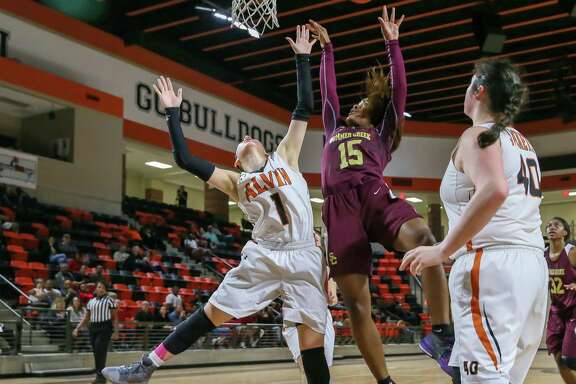 February 20, 2018:   Alvin Yellowjackets shooting guard Andreea Mancha (1) blocks a shot by Summer Creek Bulldogs shooting guard Halle Jones (15) during the Girls basketball Regional Quarterfinal playoff game between the Summer Creek Bulldogs and Alvin Yellowjackets at La Porte High School in La Porte, Texas. (Leslie Plaza Johnson/Freelance)