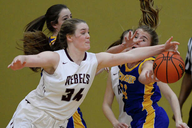 Lee's Paige Low (34) goes after a rebound against Frenship's Katelin Heise (11) in the Class 6A regional quarterfinal Feb. 20, 2018, at Follis Gym in Lamesa. James Durbin/Reporter-Telegram