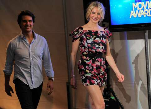 Cameron Diaz, right, and Tom Cruise are sen backstage at the MTV Movie Awards in Universal City, Calif., on Sunday, June 6, 2010. (AP Photo/Chris Pizzello) Photo: Chris Pizzello