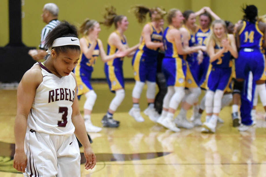 Lee's Alaysha Green (3) walks off the court as Frenship players celebrate a win in the Class 6A regional quarterfinal Feb. 20, 2018, at Follis Gym in Lamesa. James Durbin/Reporter-Telegram Photo: James Durbin