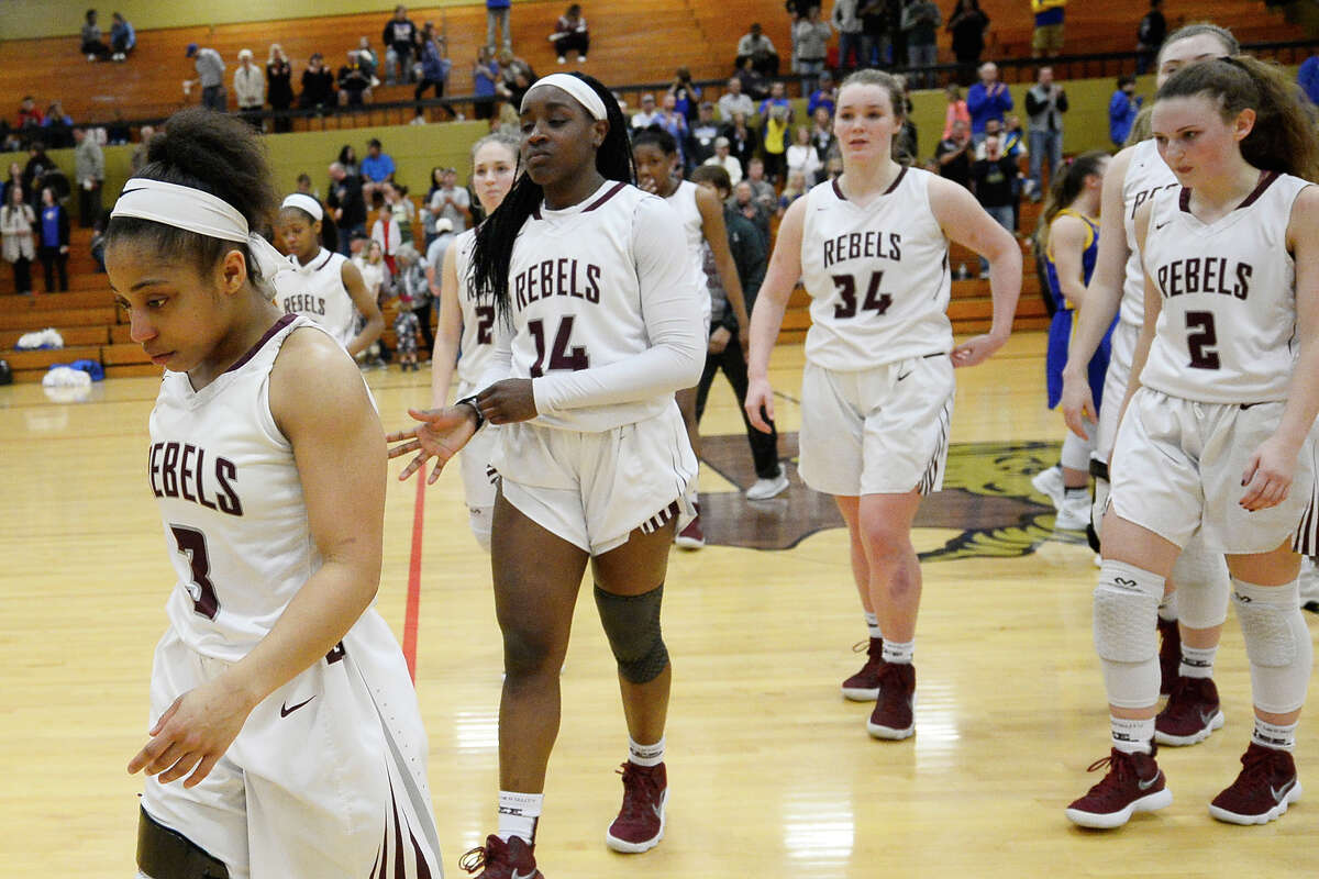 Lee's Alaysha Green (3) leads her team off the court after a loss against Frenship in the Class 6A regional quarterfinal Feb. 20, 2018, at Follis Gym in Lamesa. James Durbin/Reporter-Telegram
