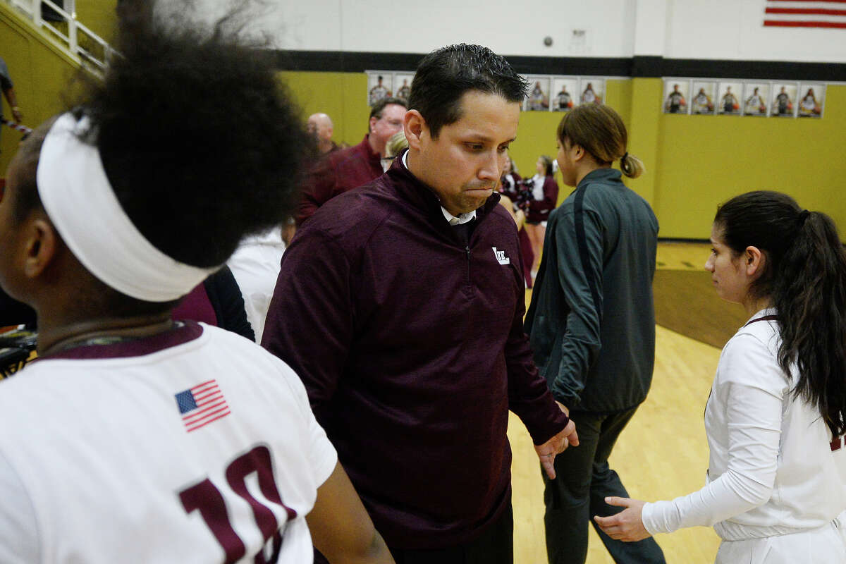 Lee girls basketball head coach Alfred Acosta reacts with his team after a loss against Frenship in the Class 6A regional quarterfinal Feb. 20, 2018, at Follis Gym in Lamesa. James Durbin/Reporter-Telegram