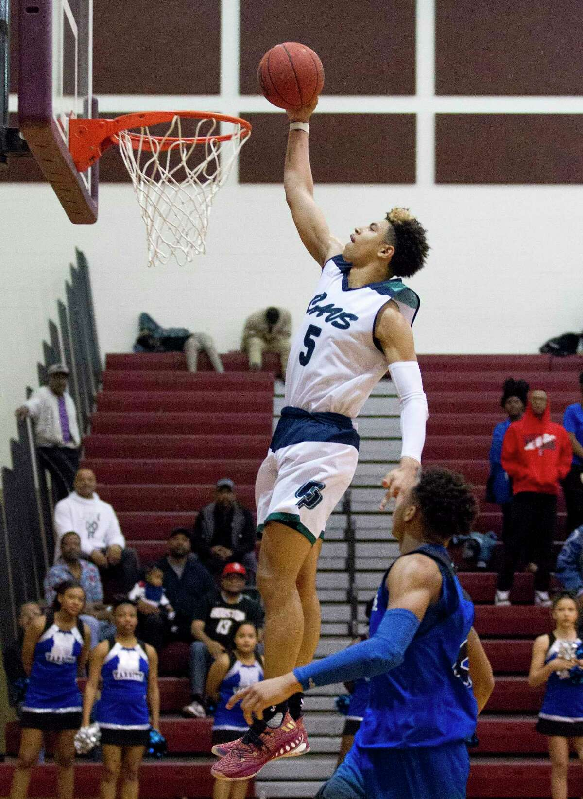 College Park guard Quentin Grimes (5) dunks the ball during the second quarter of a Region II-6A bi-district high school playoff game at Palestine High School, Tuesday, Feb. 20, 2018, in Palestine.
