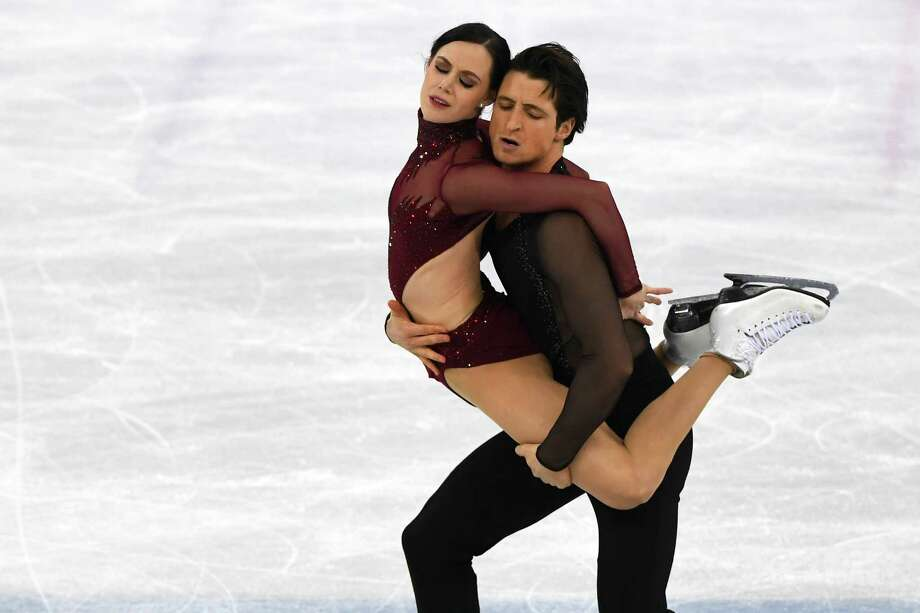 Tessa Virtue and Scott Moir of Canada compete during the free dance portion of the ice dance event at the 2018 Winter Olympics at Gangneung Ice Arena in Gangneung, South Korea, Feb. 20, 2018. In a performance by turns athletic, sensual and expressive, Virtue and Moir reclaimed the Olympic gold medal.  (James Hill/The New York Times)   -- NO SALES -- Photo: JAMES HILL / NYTNS