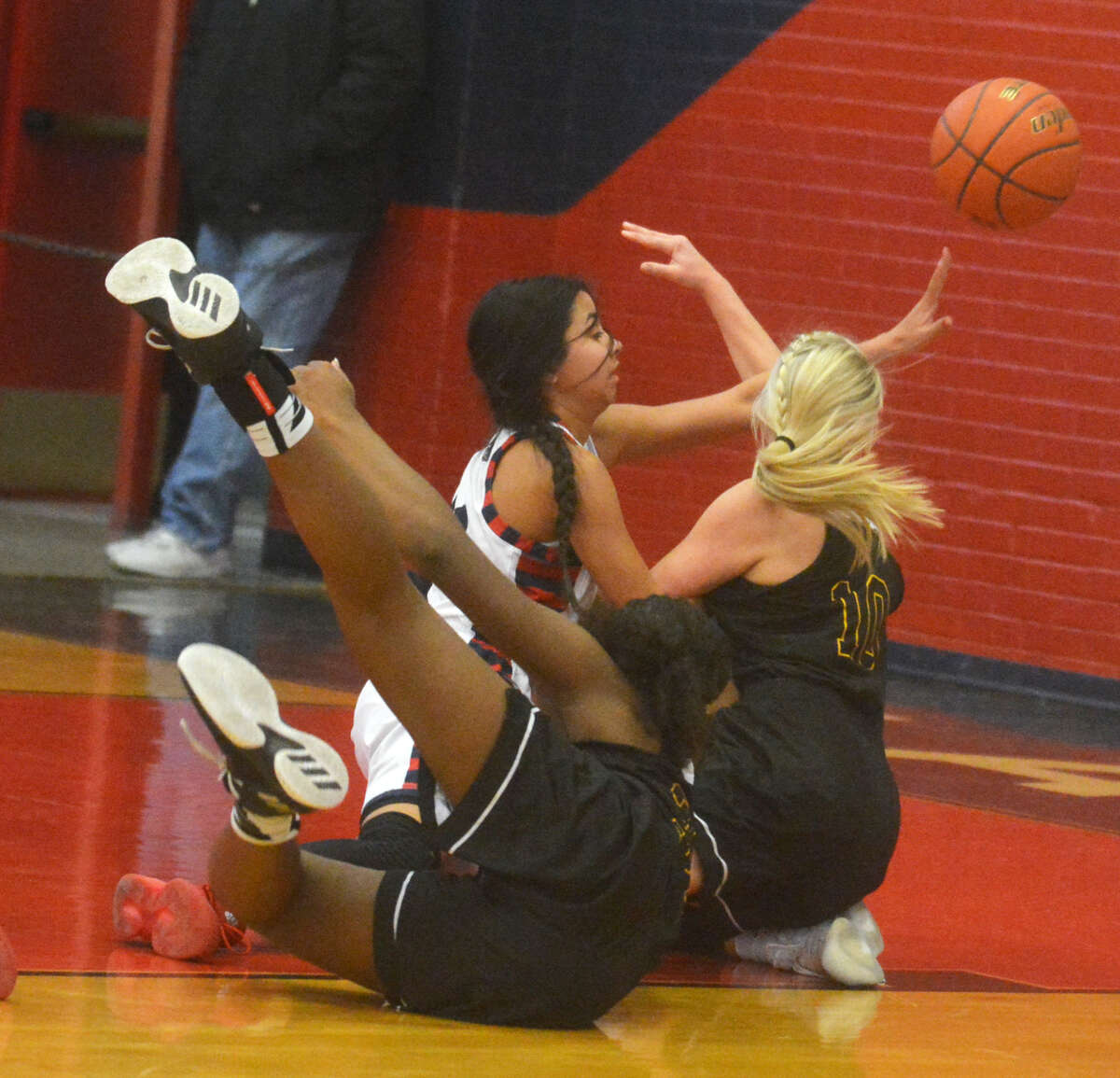 Plainview's Kristan Rincon passes the ball from her knees as she scrambles with two Amarillo High players for possession during a game earlier this season. Amarillo defeated the Lady Bulldogs in the UIL Class 5A regional quarterfinals Tuesday night, 62-41. Rincon led Plainview with 15 points. The Lady Bulldogs finish their season with a 22-15 record.