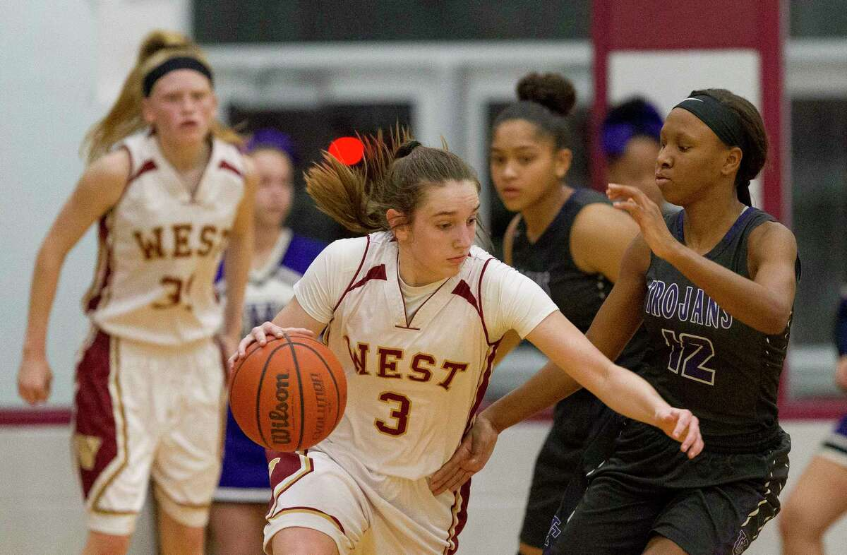 Magnolia West shooting guard Alyssa May (3) drives the ball agaisnt Waco University guard Sandra Hughes (12) during the second quarter of a Region III-6A area high school playoff game at Hearne High School, Friday, Feb. 16, 2018, in Hearne.
