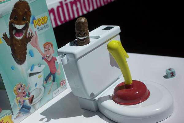 Flushin' Frenzy from Mattel is among a wave of potty-related toys hitting the market. Flushin' Frenzy sends brown plastic poop flying into the air.