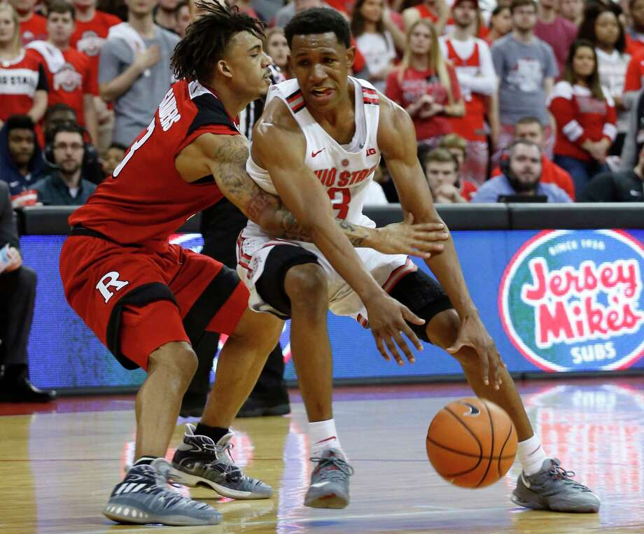 Ohio State's C.J. Jackson, right, controls the ball as Rutgers' Corey Sanders defends during the second half of an NCAA college basketball game Tuesday, Feb. 20, 2018, in Columbus, Ohio. Ohio State beat Rutgers 79-52. (AP Photo/Jay LaPrete) Photo: Jay LaPrete / FR52593 AP