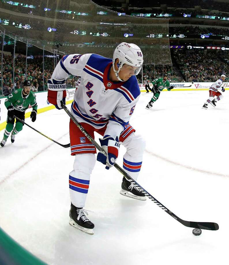 New York Rangers defenseman Nick Holden (55) controls the puck as Dallas Stars center Devin Shore (17) pursues during the first period of an NHL hockey game Monday, Feb. 5, 2018, in Dallas. (AP Photo/Ron Jenkins) Photo: Ron Jenkins / FR171331 AP