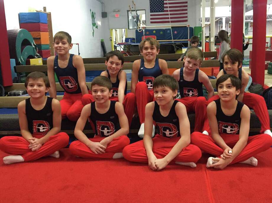 The Darien YMCA boys team competing in Simsbury included Level 5 gymnasts (bottom row) Ryan Hough, Ryland Herzog, Egor Vasilyev and Nate Smith and Level 4s (top row) Jackson Lawrence, Jake Simon, George Callahan, Maxwell Kagels and Derin Leon. Photo: Contributed Photo / Darien News contributed