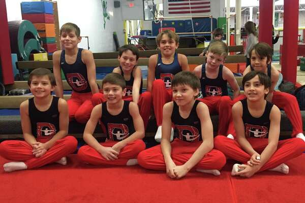 The Darien YMCA boys team competing in Simsbury included Level 5 gymnasts (bottom row) Ryan Hough, Ryland Herzog, Egor Vasilyev and Nate Smith and Level 4s (top row) Jackson Lawrence, Jake Simon, George Callahan, Maxwell Kagels and Derin Leon.