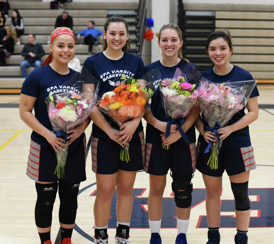 The four members of the Greens Farms Academy girls basketball program who played their final home game at Coyle Gym last week, included, from left, Hannah Kozdeba (Shelton), Alex Wagner (Southport), Bella Litt (Darien) and Molly Mitchell (Southport). Photo: Contributed Photo