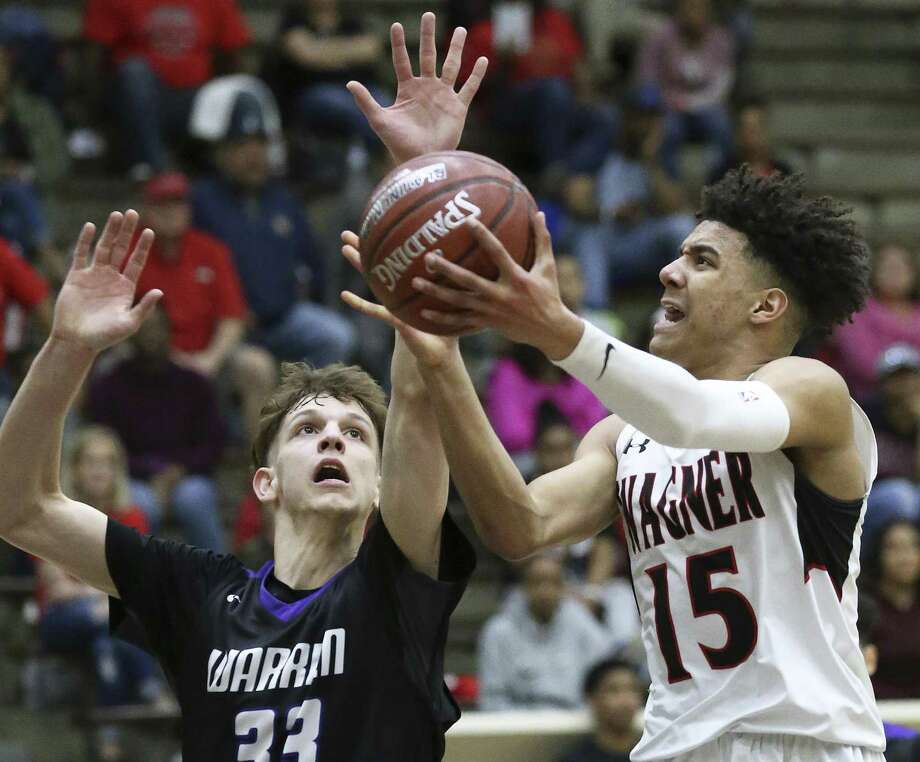 Kevin McCullar gets a shot offf for the T-Birds against  Adrian McConnell as Wagner plays Warren in bidistrict basketball action at the Alamo Convocation Center on February 20, 2018. Photo: Tom Reel, Staff / San Antonio Express-News / 2017 SAN ANTONIO EXPRESS-NEWS