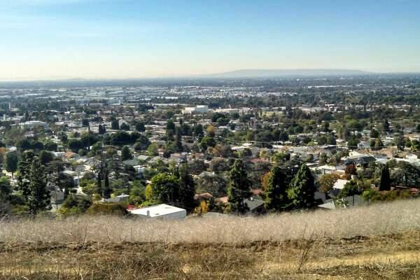 A snapshot of the city of Whittier, and other parts of Los Angeles in the distance, from atop a hill.
