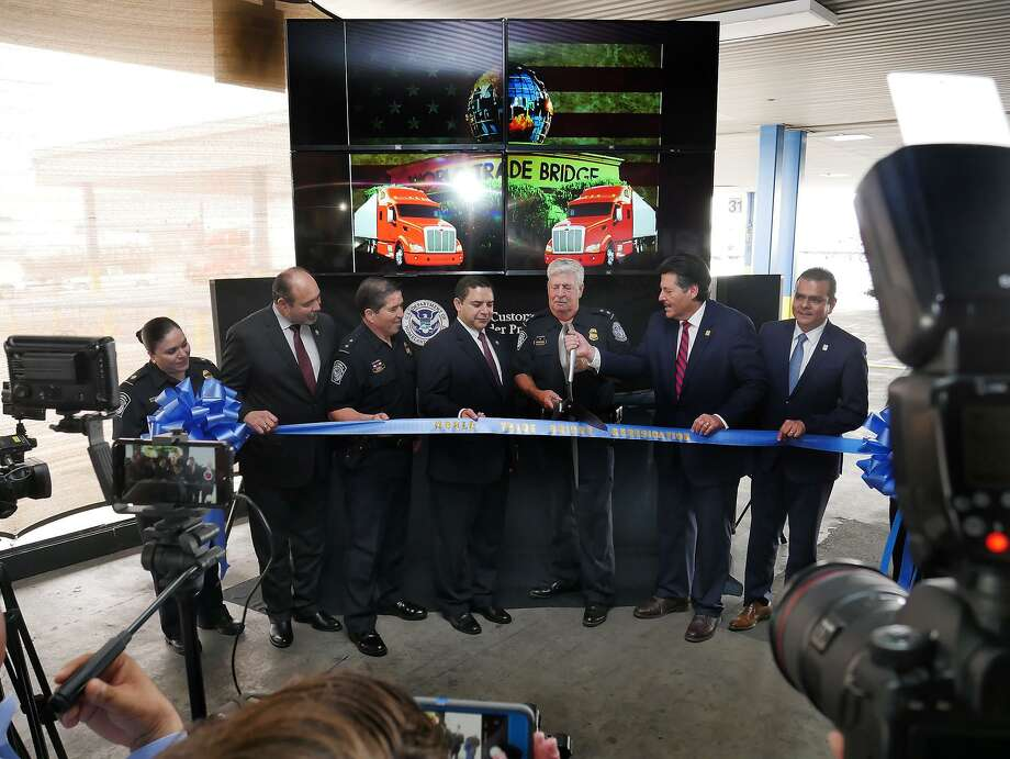 U.S. Customs and Border Protection, together with elected officials and private sector stakeholders, gathered Tuesday to officially commemorate the buildback of the World Trade Bridge facilities following a weather event in May that caused extensive damage. Photo: Cuate Santos /Laredo Morning Times / Laredo Morning Times