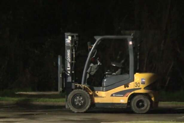 Two people are in custody after they used forklifts to steal an ATM machine from a bank on the North Freeway, Feb. 21, 2018.