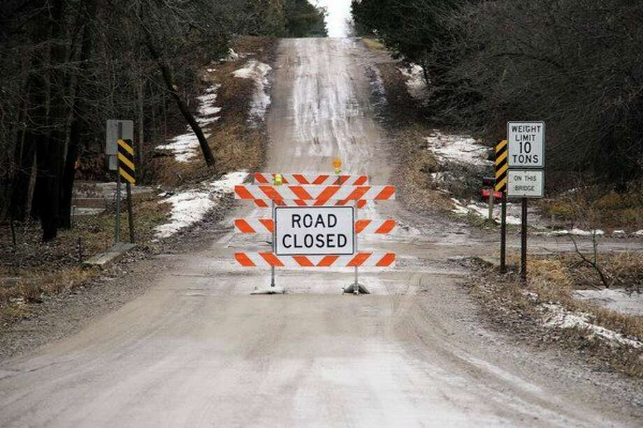Hartsell Road over the Pigeon River was closed between Sebewaing Road and Canboro Road on Tuesday in Grant Township. (Seth Stapleton/Huron Daily Tribune)