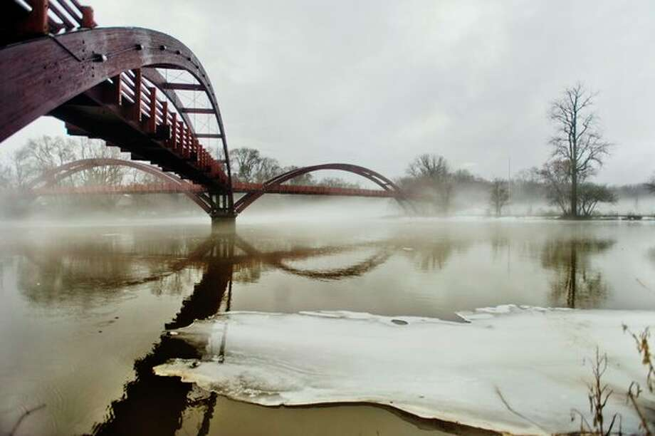 Fog blankets the Tridge on Tuesday morning in Midland. The Tittabawassee River is expected to crest at 23.8 feet Thursday morning, just below the official flood stage of 24 feet. (Katy Kildee/kkildee@mdn.net)