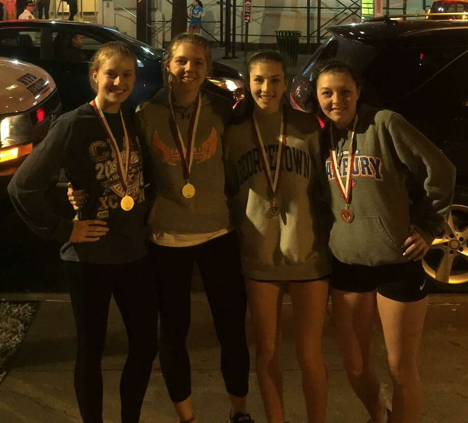 The Danbury High School girls indoor track and field team's distance medley relay team of Leah Sarkisian, Olivia Turk, Cassandra Sturdevant and Lauren Moore placed fourth at the Eastern States Championships on Feb. 20, 2018 at the Armory in New York City. Photo: Contributed Photo / Contributed Photo